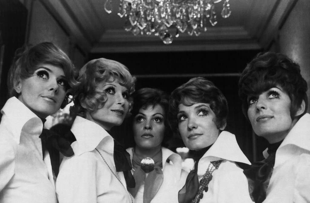 """A bevy of Parisian models display the """"N"""" hair creations of the French haute coiffure union in Paris on Feb. 27, 1969. The """"N"""" is for Napoleon, whose 200th birthday is being celebrated this year and from whose era the new hairstyle is adapted. (AP Photo)"""