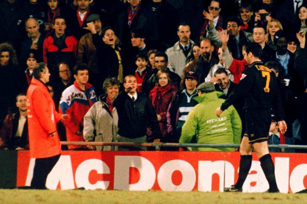 A Crystal Palace fan shouts abuse at Eric Cantona following his sending off