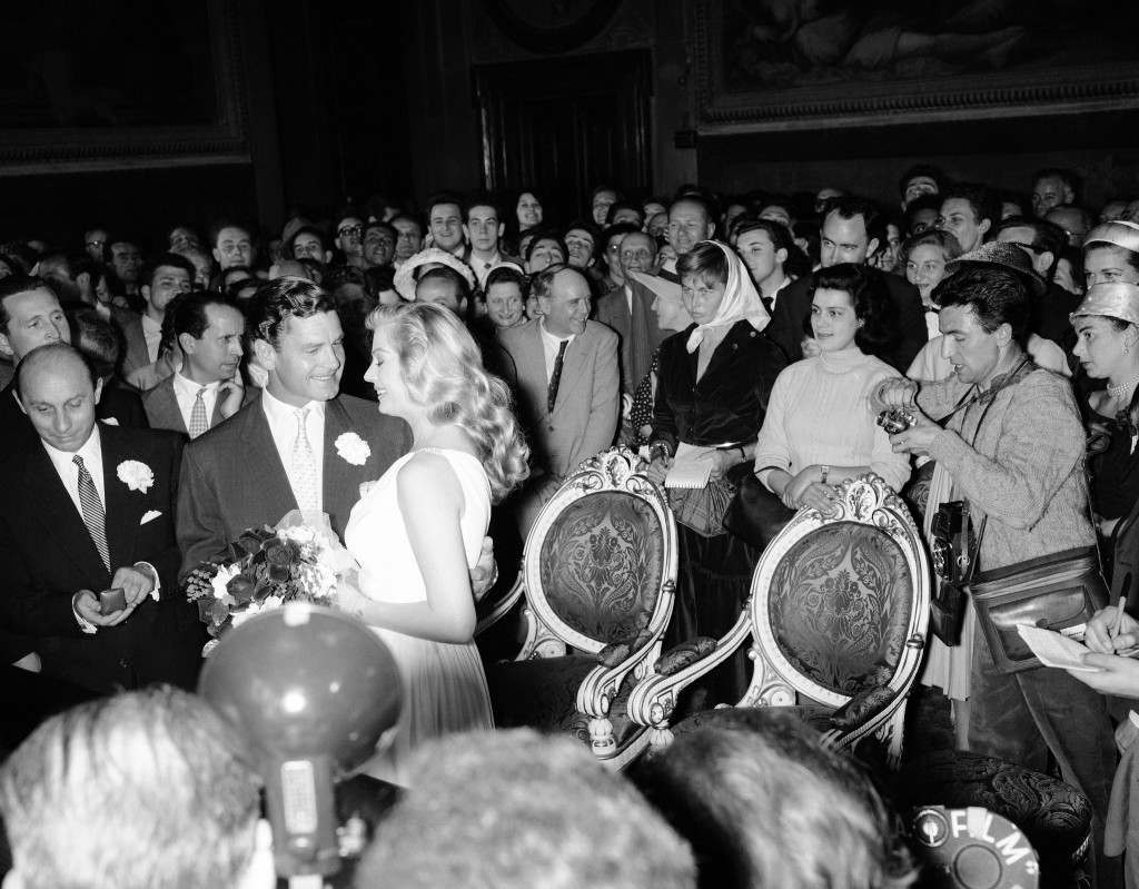 British actor Anthony Steel, second from left, and Swedish-born actress Anita Ekberg during their wedding ceremony at the City Hall in Florence, Italy on May 22, 1956. (AP Photo/Raoul Fornezza/Walter Attenni)