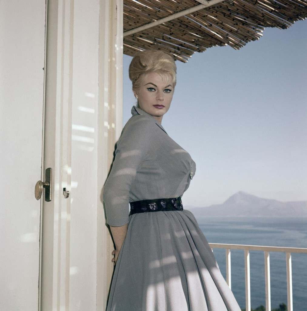 "Swedish actress Anita Ekberg poses on the terrace of her hotel in Maratea, a small hilltown on the South Italian west coast on Nov. 29, 1960, where she is starring in a new film, ""Behind Closed Doors"", opposite American actor Fred Clark and Italian actor Claudio Gora. It is an Italian picture, directed by Dino Risi, and Miss Ekberg plays the part of a woman accused of having murdered her husband. (AP Photo/Mario Torrisi)"