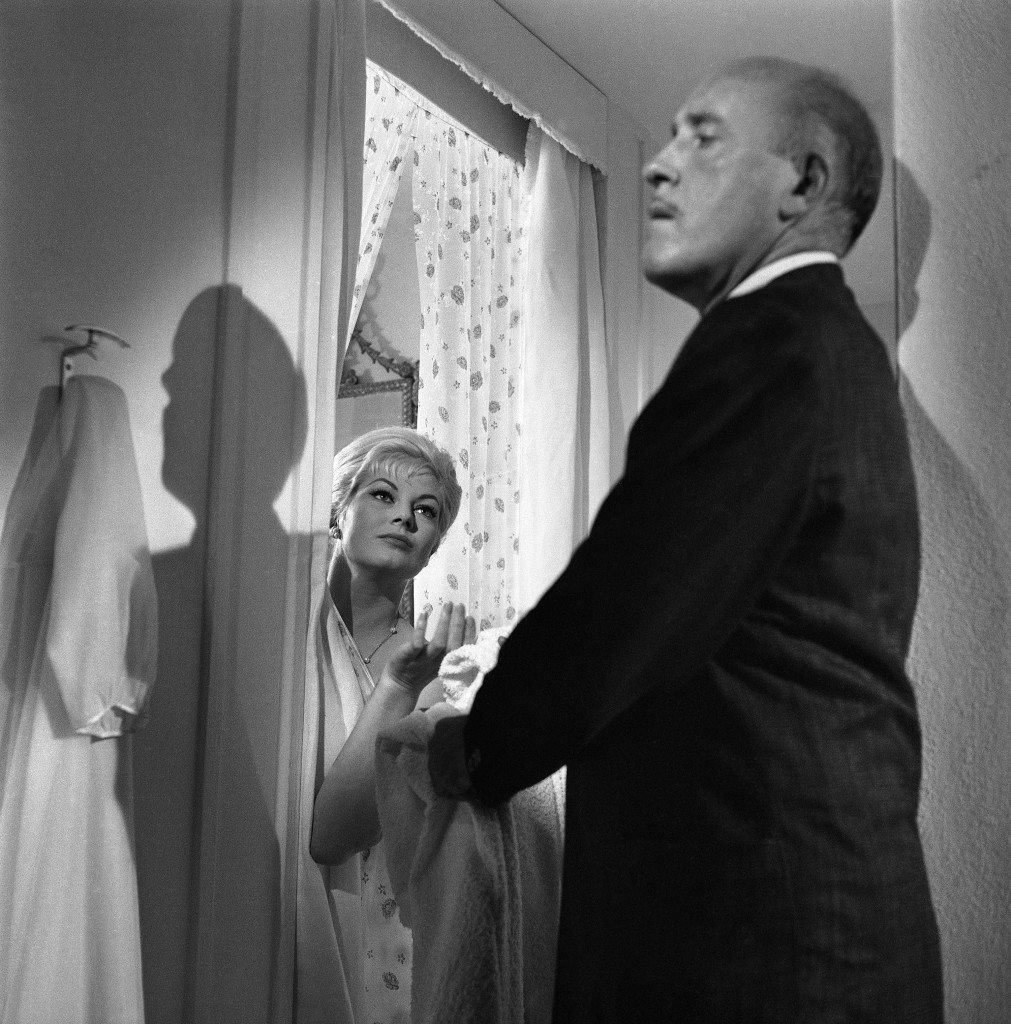 "Swedish actress Anita Ekberg looks coquette in a scene of the film ""Behind Closed Doors"", directed by Italian Dino Risi during shooting at Maratea, on the South-Italian west coast on Nov. 28, 1960. Miss Ekberg plays the part of the woman accused of having murdered her husband. It is an Italian production. (AP Photo/Mario Torrisi)"