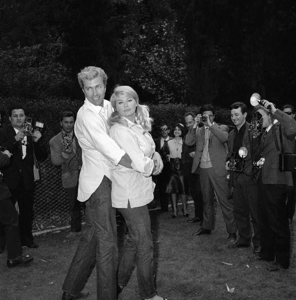 "Swedish-born actress Anita Ekberg and her Austrian-born American actor-husband Frederick (Rik) Van Nutter pose in the garden of her Rome villa, Italy, at the outskirts of the city on April 17, 1963, as they received newsmen there. It was the couple's first appearance in public since their surprise marriage on April 9, 1963 in the town hall of Vignanello, a suburb of Lugano, Switzerland. Miss Ekberg will leave next month for the United States, where she will play in ""Two for Texas"", a Robert Aldrich movie starring Frank Sinatra and Dean Martin. (AP Photo/Mario Torrisi)"
