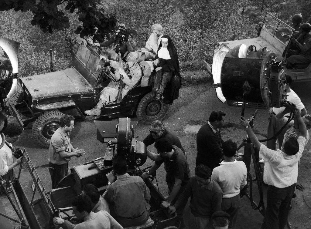 "A scene of a new Italian film, ""Apocalisse sul Fiume Giallo"" (verbally: ""Apocalypse on the Yellow River""), being shot in the woods at Tivoli, about 35 kilometers (22 miles) east of Rome, Italy on Sept. 24, 1959. In a military jeep sit Anita Ekberg (in right background) and Franca Bettoja, the latter holding a wounded Chinese girl, played by Chinese actress Mei-Lang-Chang. Swedish-born actress Anita Ekberg plays the main female part of an American nurse, opposite French actor Georges Marchal in the part of an American journalist, while Italian actress Franca Bettoja has the role of a Catholic nun in the film. The picture tells the story of the Nationalist Chinese forces' desperate fight against the communist forces, of the latter's plan to blow up the dikes of the Yellow River, of an American journalist who happens to learn about this plan and eventually saves the dike from a major disaster and thus his love with an American nurse. (AP Photo/Mario Torrisi)"