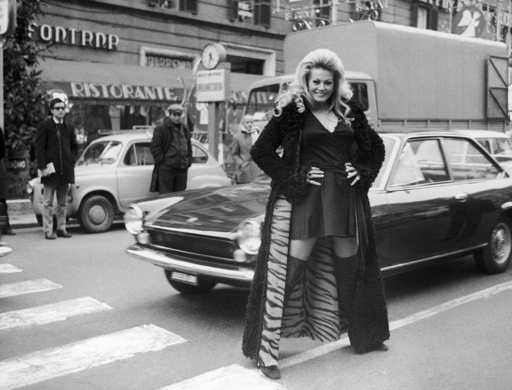 "Swedish actress Anita Ekberg, donning a mini-maxi combination, strolls at Rome's fashionable street Via Veneto, Italy on January 10, 1970, the street where Federico Fellini's film ""La Dolce Vita"" (The Sweet Life) was located, in which Miss Ekberg won fame in the leading part. Miss Ekberg who now is a resident of Rome, was leaving a party for movie celebrities. (AP Photo)"