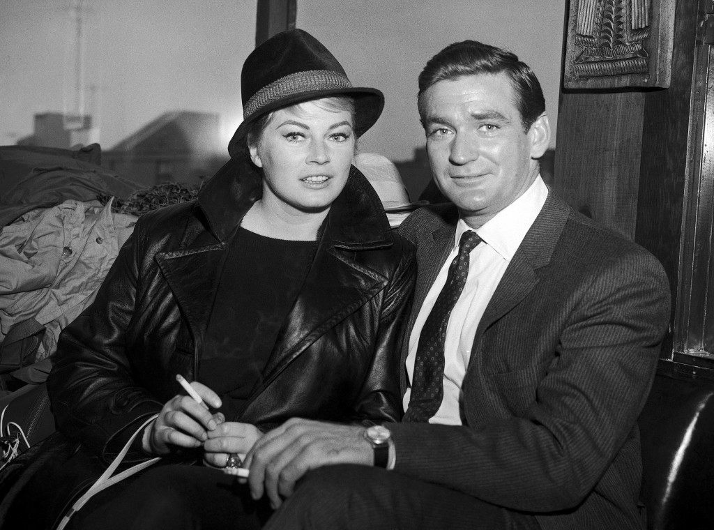 "Swedish actress Anita Ekberg and Australian-American actor Rod Taylor, who plan to marry soon, are seen in San Francisco, United States on May 9, 1962, where she was visiting Taylor during location filming for his new 20th Century Fox TV series ""Dateline: San Francisco."" Taylor plays the part of a newspaper columnist in the television series. (AP Photo)"