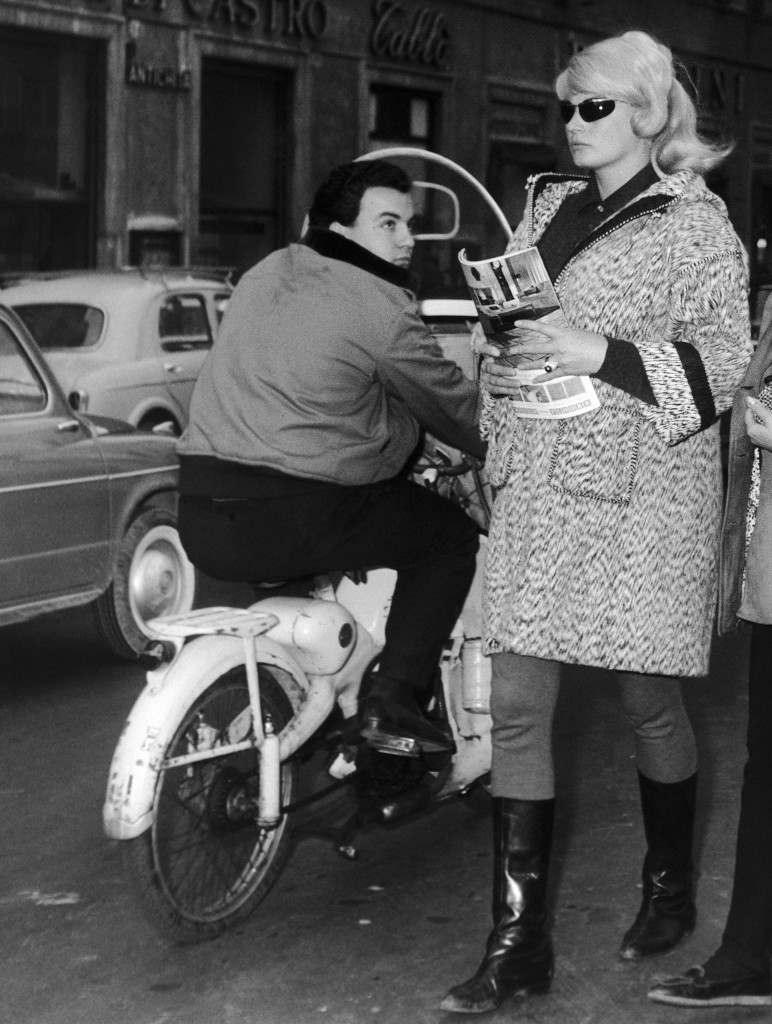 "Swedish actress Anita Ekberg receives an admiring glance from a motorcyclist, as she goes shopping in downtown Rome, Italy on Nov. 29, 1963. Miss Ekberg is just back in Rome from Hollywood where she has finished her work in the movie ""Four for Texas"". She is domiciled here. (AP Photo) Ref #: PA.12194642  Date: 29/11/1963"