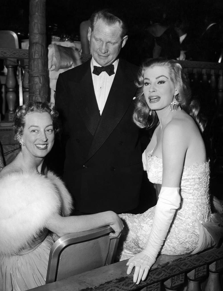 "Swedish film star Anita Ekberg visits with Swedish Consul Walker G. Danielson and Mrs. Danielson at the Foreign Press Association Awards banquet in Los Angeles, United States on Feb. 23, 1956. Miss Ekberg was picked as one of the ""stars of tomorrow by the foreign reporters of Hollywood. (AP Photo)"