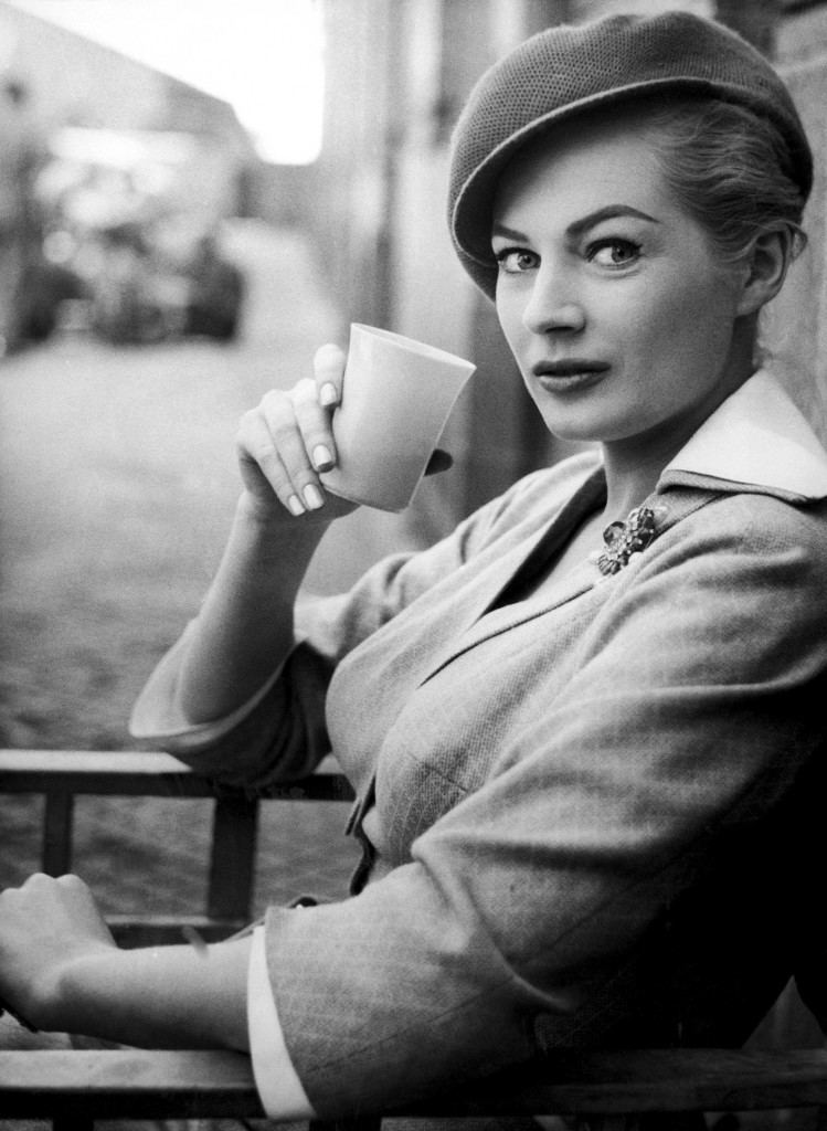"Swedish actress Anita Ekberg, wearing a chic cap-like beret and sipping a soft drink, relaxes during a break in the shooting of a scene for the Warwick films movie ""The Man Inside,"" in Madrid, Spain on May 7, 1958. Hollywood's Jack Palace also stars in the film, exteriors for which are being shot in Madrid. (AP Photo)"