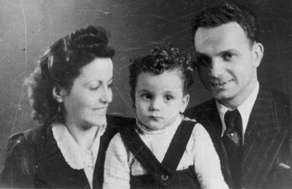 This undated photo taken by Wilhelm Brasse and released by the Auschwitz Museum, shows SS officer Fremel Rudolf with his wife, and son.