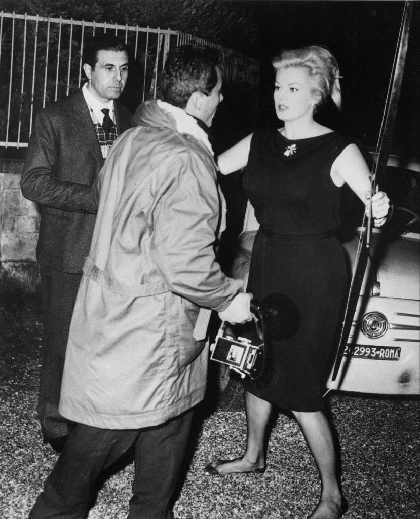 Swedish-born actress Anita Ekberg confronts Italian freelance photographer Felice Quinto with a bow and arrow outside her villa in Rome, Italy, late at night on Oct. 19, 1960. Ekberg quarreled with the photographer claiming she had been pursued all the time from the nightclub to her home. Standing watching at left is film producer Guido Giambartolomeo. (AP Photo/Marcello Geppetti)