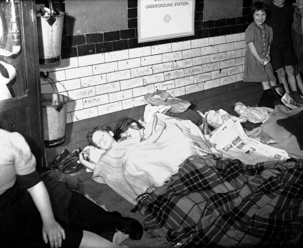 Children sleep on the platform of a London Underground station, where they are sheltering with their families during the all night Nazi bombing raids.