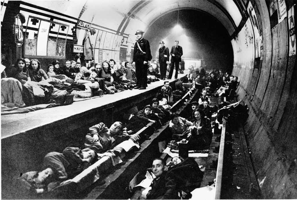 Londoners camp out for the night at the tube along the platform and train tracks during heavy bombing by the Germans in London, England, on Oct. 21, 1940 in World War II. Families fled their homes at the sound of the air raid sirens, and will remain here until the air raid wardens notify them of the all-clear signal. (AP Photo)