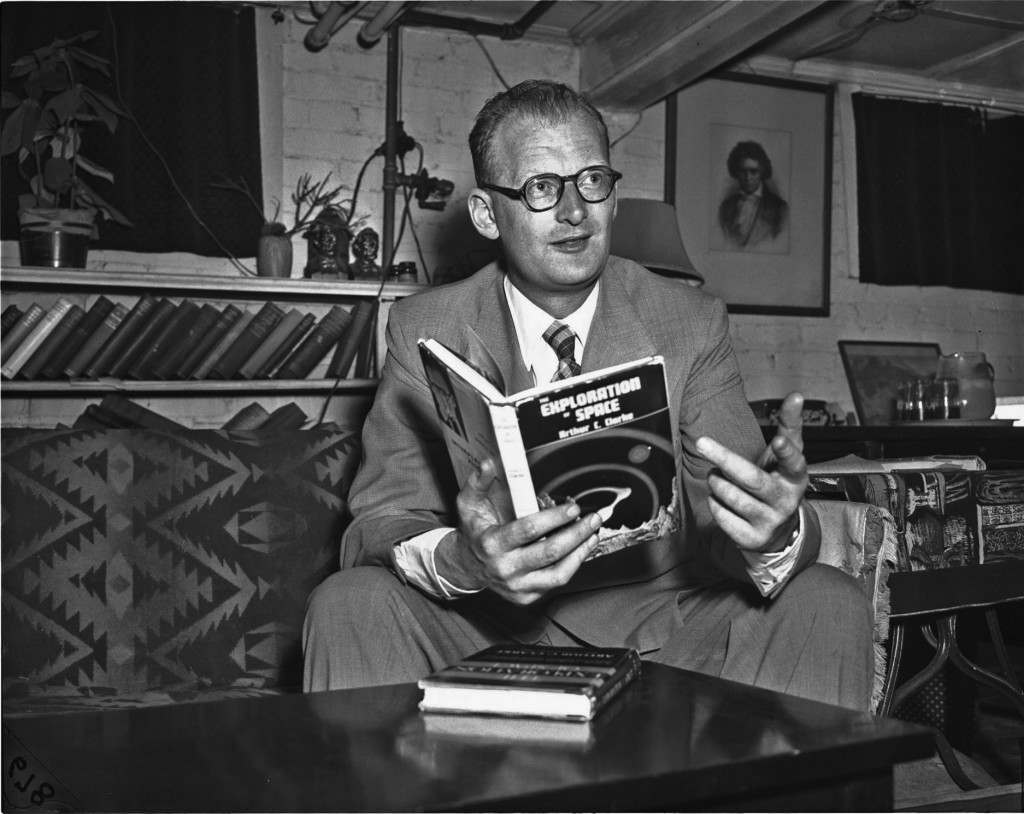 "Science fiction author Arthur C. Clarke holds a copy of his book, ""Exploration of Space"" at a home in Washington, D.C., in this June 9, 1952 file photo."