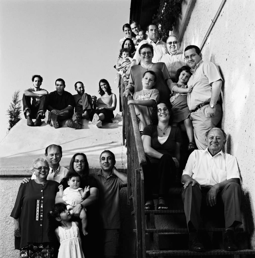 Holocaust Survivor Tzvi Kretz, bottom right, is seen outside his house with his family in Jerusalem in this photo taken September, 2007. Kretz was born in 1924 in what was then Czechoslovakia, where he survived the Chust Ghetto and in 1944 was transferred to Auschwitz-Birkenau where he was separated from his mother and three siblings. He never saw them again. Israel's annual Holocaust Heroes and Martyrs Remembrance Day for 6 million Jews who were killed by German Nazis and their collaborators in World War II begins at sundown Wednesday April 30, 2008.(AP Photo/Oded Balilty)
