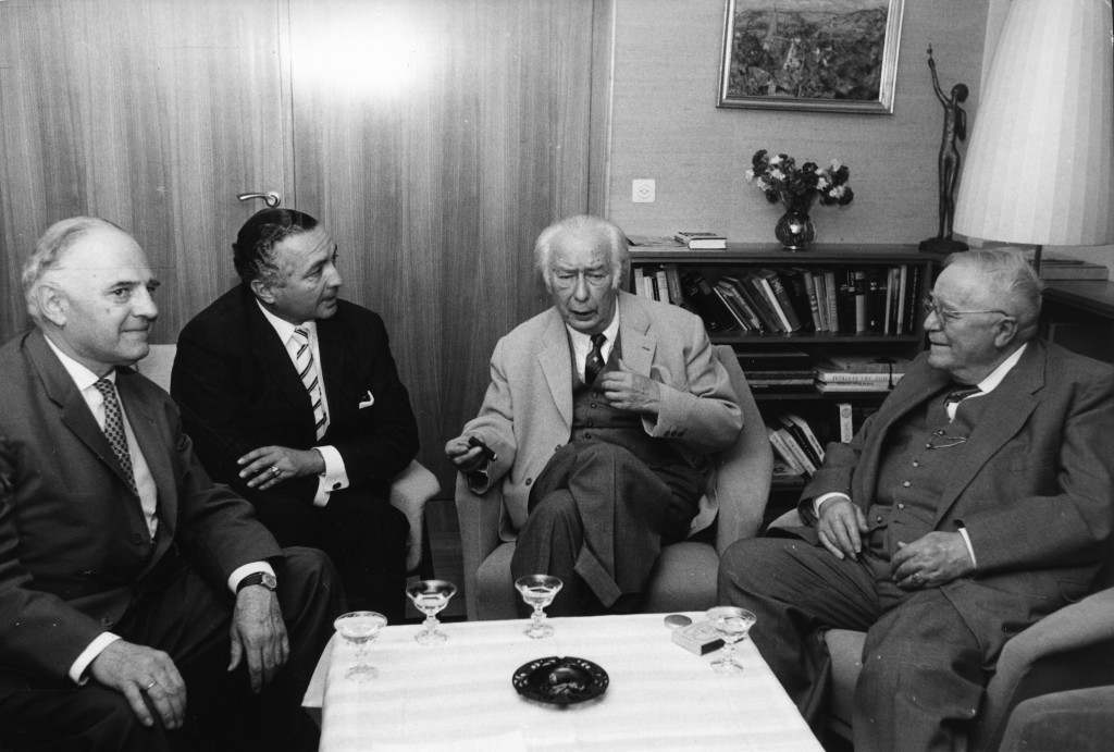 Dr. Wolfgang Haussmann, Dr. Erich Mende, Prof. Theodor Heuss and Dr. Reinhold Maier are pictured during a meeting at the home of former west German president Heuss upon his invitation of Free Democrats (FDP) members in Stuttgart, West Germany, September 13, 1961. (AP Photo)
