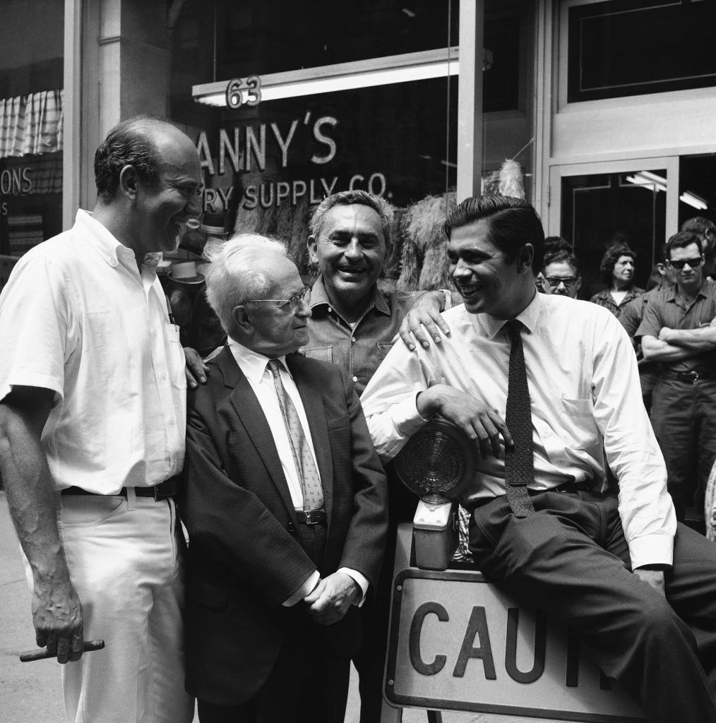 In between shootings, producer-director (and TV comic) Carl Reiner, left, discusses the scene to be played with the star, Reni Santoni, right, while on location for Columbia Pictures version of the same-name Broadway comedy, Enter Laughing, West 38th Street, Aug. 9, 1966, New York.
