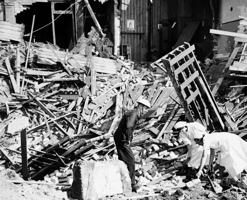 An Air Raid Prevention officer and some nurses try to salvage any vital supplies from the rubble of a hospital in London's East End, that was hit during an air raid.