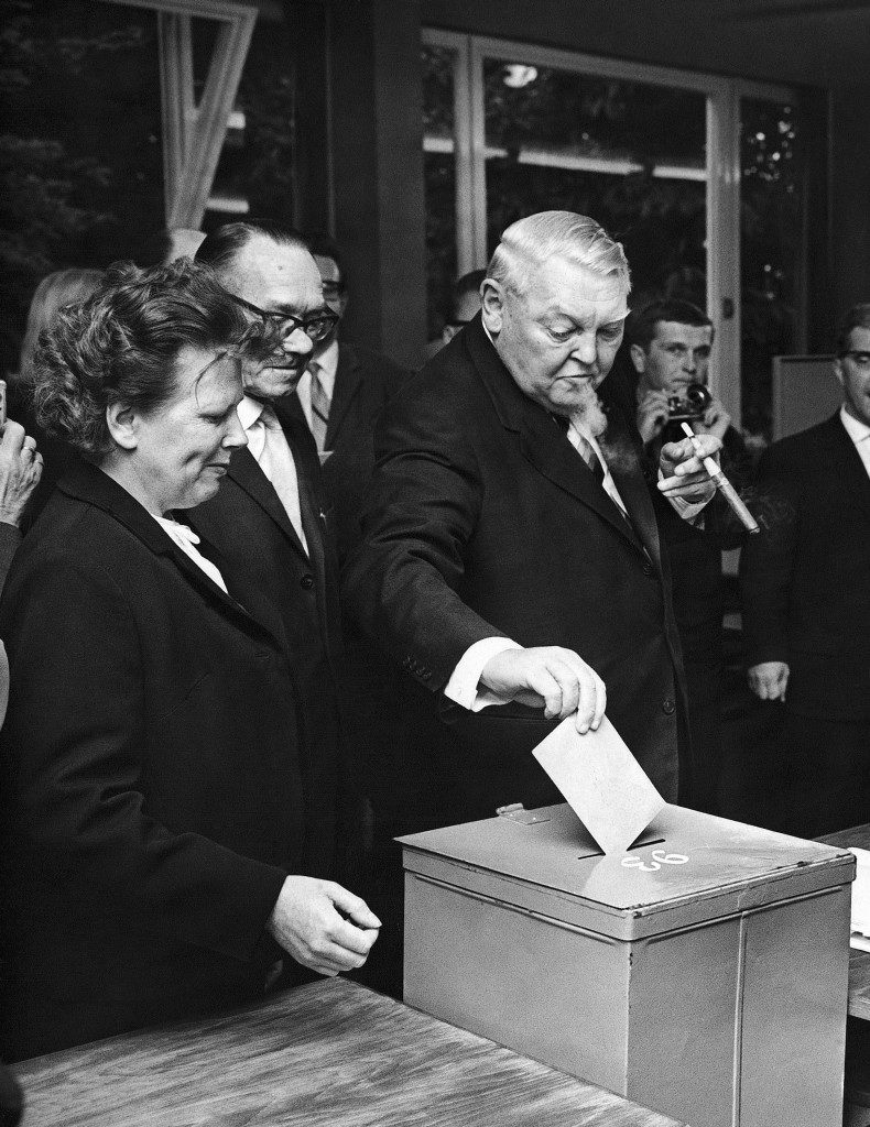 Puffing at his cigar, Ludwig Erhard, Chancellor of West Germany, casts his ballot as he votes in the General Election on September 26, 1965 in Bonn, Germany. The result was a win for his Christian Democratic Party. (AP Photo)