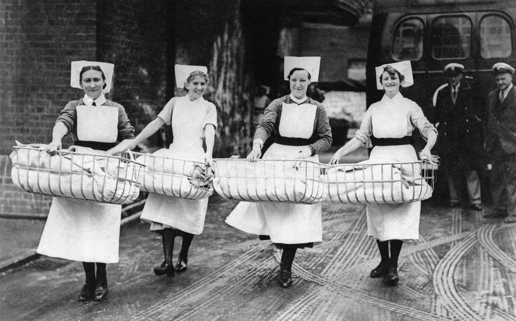Nurses carry cribs containing newly born babies, the maternity section of a southeast London hospital was evacuated,+ Sept. 16, 1940 after being bombed by German raiders the night before. (AP Photo)
