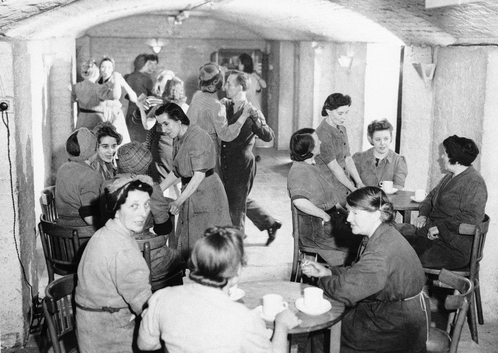 The underground factory's night club is a simple affair where some of the workers drink tea while others dance somewhere in England, April 11, 1944. (AP Photo)