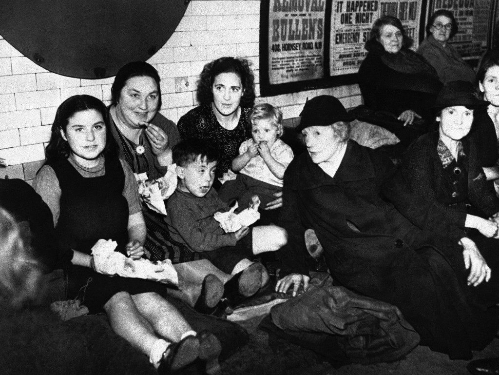 Deep underground, thousands of Londoners nightly wait out the danger of German air raids on the capital in London, Oct. 1, 1940. The bomb fugitives break the monotony of a night-long wait with luncheon underground. (AP Photo)