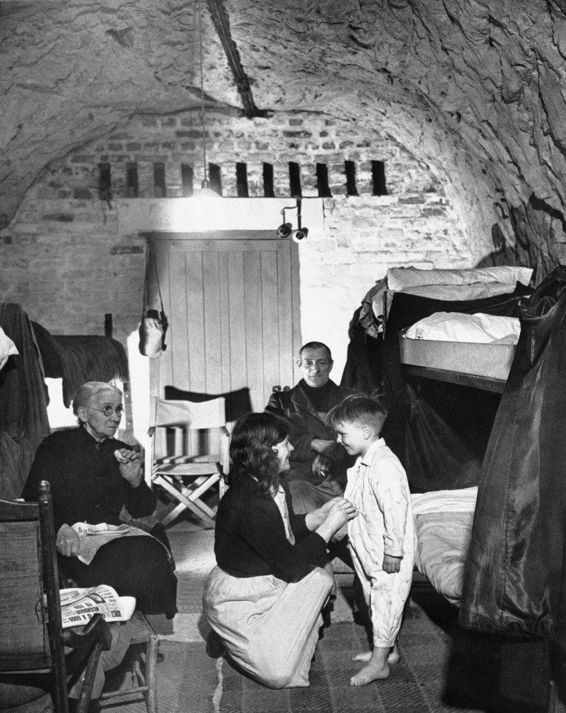 Five-year-old David Day is prepared for bed in his home is a cave in Dover?s chalk cliffs on the English Channel Coast in Dover, England, April 19, 1944. About 90 of the city?s residents have become permanent residents of caves to evade danger and harm from German shells and bombs. David remembers no other home, having become a cave dweller at five months of age. (AP Photo)