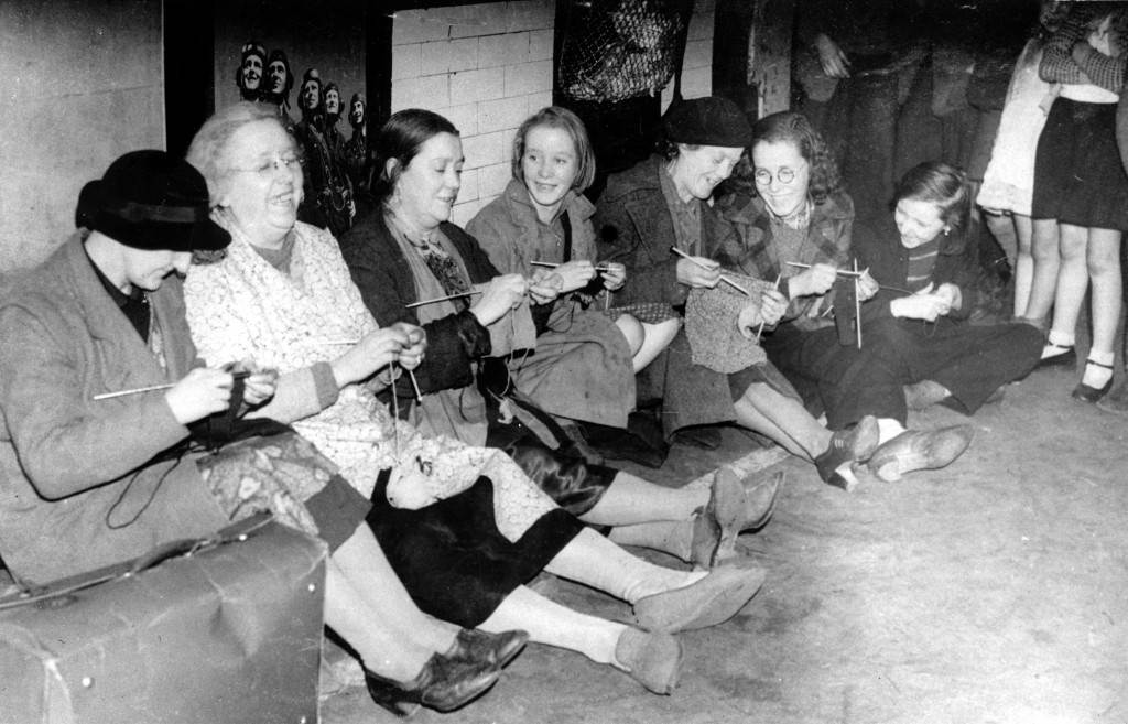 Women knit and talk as they seek shelter in the tube station during heavy bombing by the Germans in London, England, in 1940 during the blitz in World War II. (AP Photo)