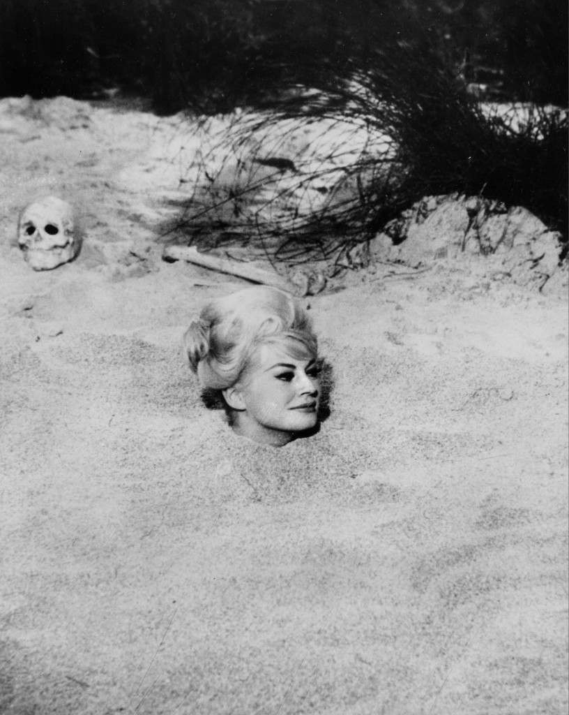 Swedish actress Anita Ekberg is buried up to her neck in beach sand in a scene from the movie Ref #: PA.8659034  Date: 01/12/1962