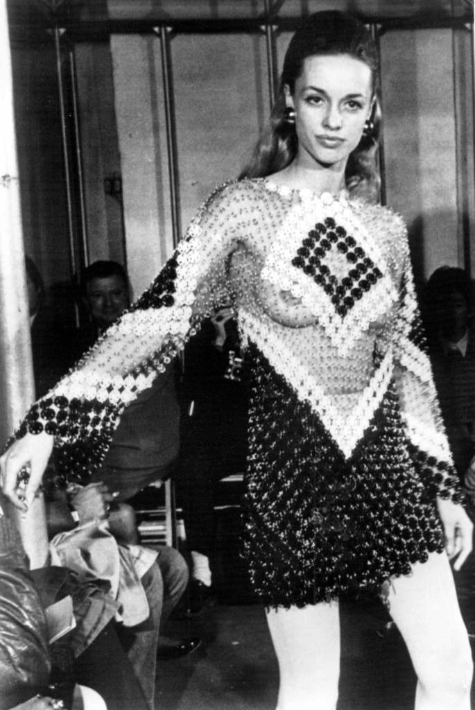 Paris couturier Paco Rabanne presents a long-sleeved minidress of black and white plastic discs revealing the upper torso in his spring and summer collection in Paris, France, on January 29, 1969. (AP Photo)