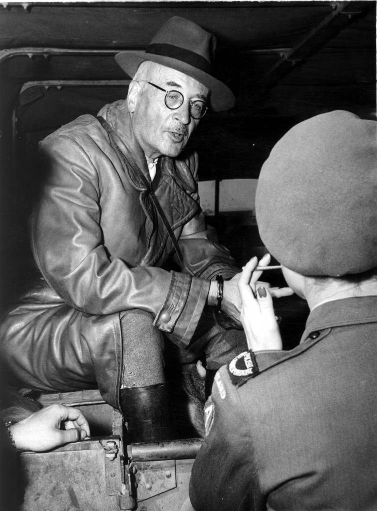 Dr. Kurt von Burgdorff, the former governor of Krakow in Poland, in handcuffs, at Fuerth Airport after before transportation to Warsaw. Burgdorff and the Governor of Auschwitz Extermination Camp, Rudolf Hoess, having finished giving evidence to the International Military Tribunal in Nuremburg, were transported to Poland to face charges including genocide at the Polish Tribunals. Ref #: PA.8697322