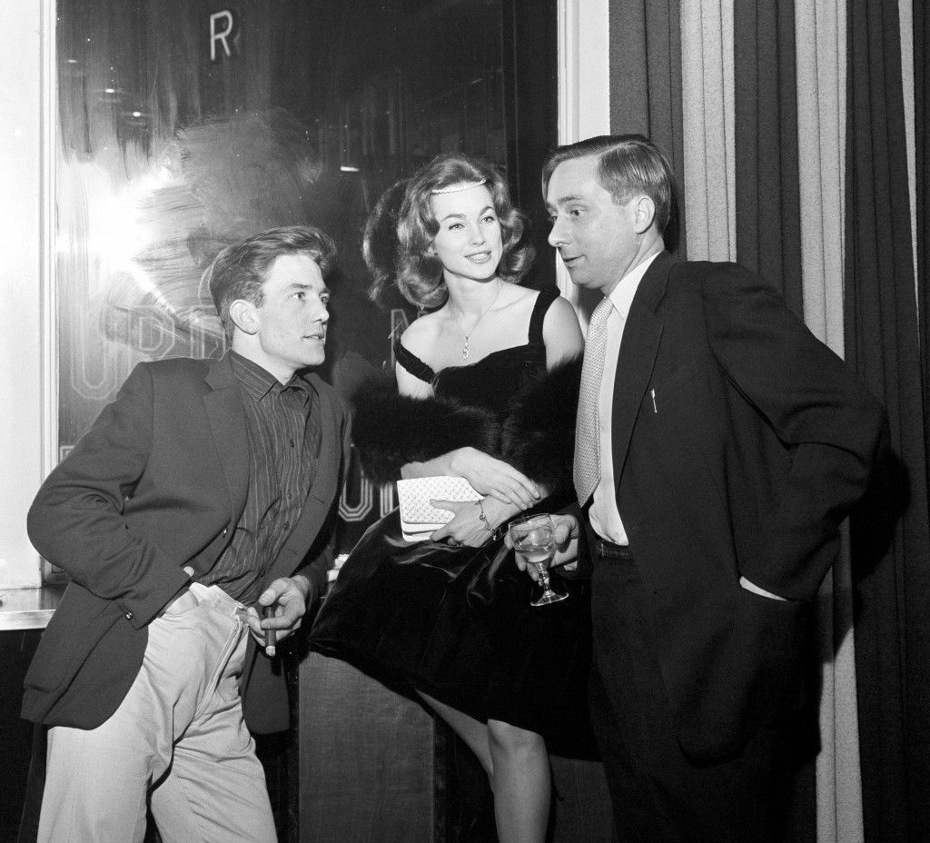 Star of the film Albert Finney (l) co-star Shirley Anne Field and author Alan Sillitoe (r) pictured in a London pub when attending a pre-premier party of 'Saturday Night and Sunday Morning' which opens at the Warner Theatre. Many stars attended the party held to get the new film off to a good start. Shortly after this picture was taken Albert Finney made his way to the Cambridge Theatre where he is currently starring in 'Billy Liar'. Ref #: PA.8749678