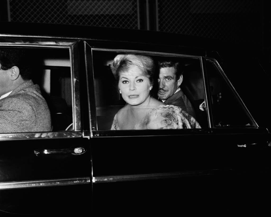 Swedish actress Anita Ekberg and Hollywood actor Rod Taylor in a car as they leave a fashionable Rome nightclub, Nov. 20, 1961. Miss Ekberg and Rod Taylor have been seen often together in Rome. He is presently shooting the film ?The King of seven Seas?. (AP Photo/Umberto Salvemini)