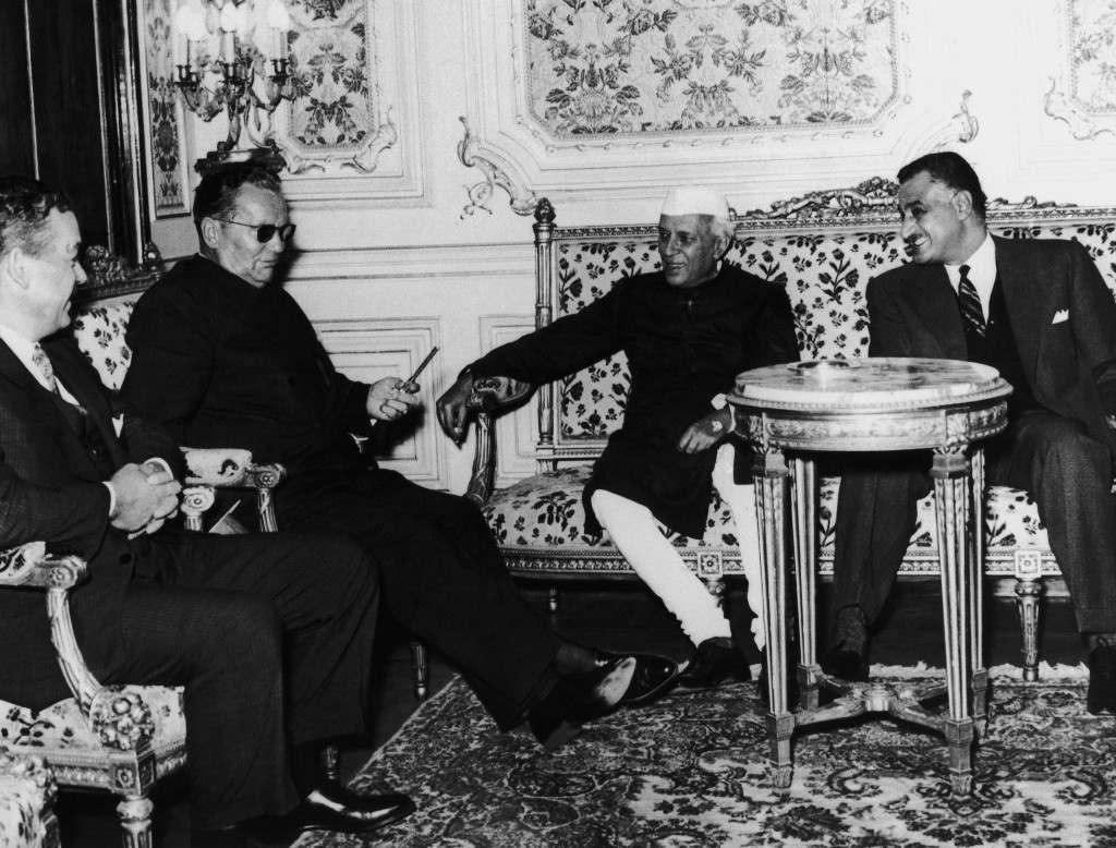 President Gamal Abdel Nasser, right, provides a light for the cigar of President Josip Broz Tito of Yugoslavia after the latter's arrival at the Presidential Kubbeh Palace in Cairo, Egypt on Nov. 17, 1961. Tito has just arrived from Belgrade for a meeting in Cairo with Nasser and India's Premier Nehru, center. (AP Photo)