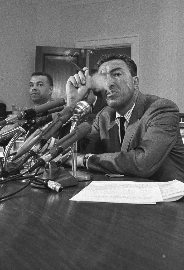 Rep. Adam Clayton Powell (D-N.Y.), blows a cloud of cigar smoke at a Capitol Hill news conference in Washington, May 12, 1965. Powell, chairman of the House Education and Labor Committee, announced a victory in his campaign to increase the participation of the poor in the anti-poverty programs. In return for pledges on that point he promised fast action on a bill, which he had been holding up, to extend and expand the operation. (AP Photo/Charles Gorry)