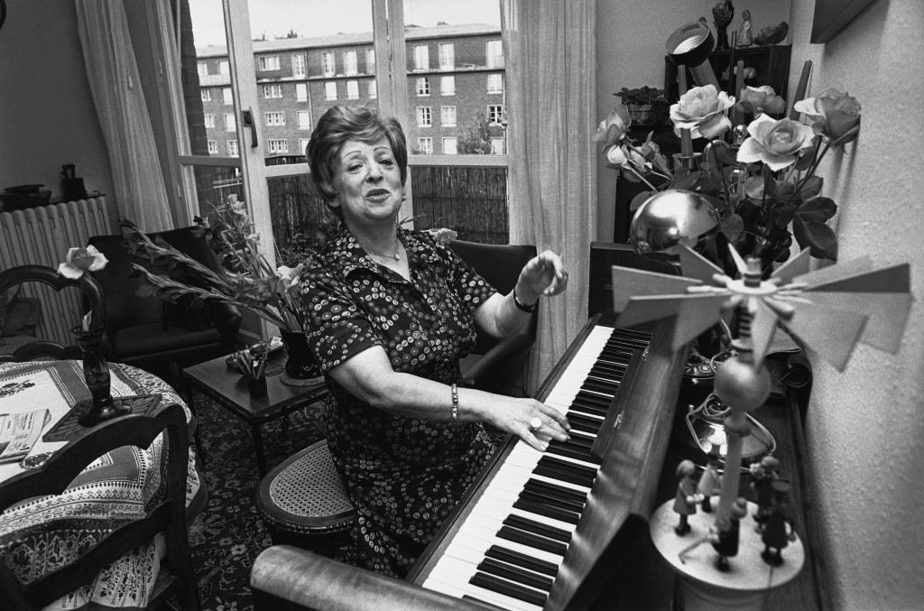 Musician and holocaust survivor, Fania Fenelon at her piano in her Paris apartment. She was forced to play in the infamous Women's Orchestra of Auschwitz during the war. Ref #: PA.9306418  Date: 10/08/1979