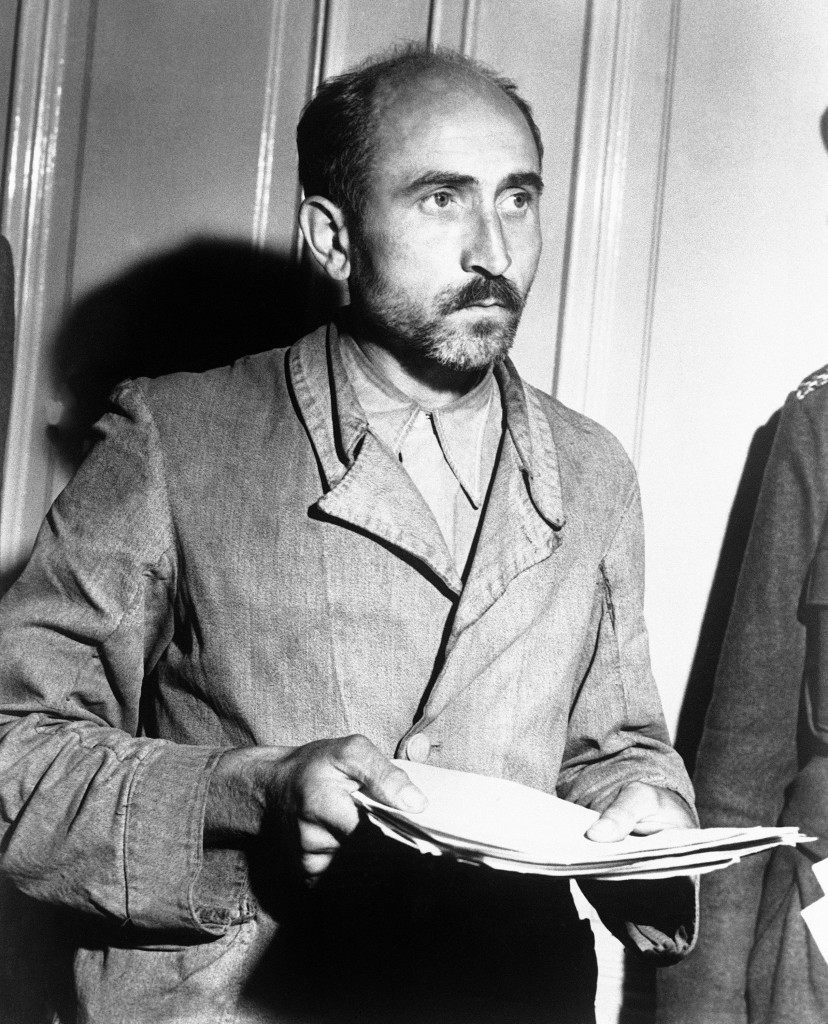 Ernest Gradner, former commander of the Auschwitz Political Prison Camps is being held in Vienna on Aug. 28, 1945, pending his trial on a war crimes charge. He was captured on a farm fifty miles from Vienna, where he had been working. (AP Photo)