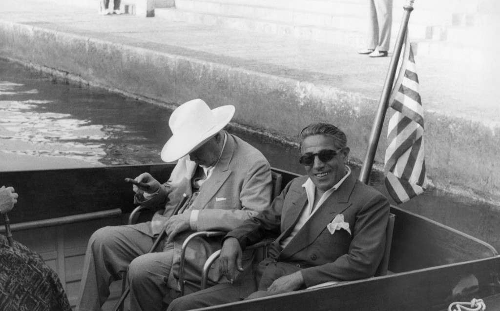 "Sir Winston Churchill with cigar still burning, nods as if having a sleep, on board the Yacht ""Christina"" owned by Greek shipping magnate Aristotle Onassis, at Cartagena, Spain, Sept. 28, 1958 during his current Mediterranean Cruise. Onassis shown at right. 1958."