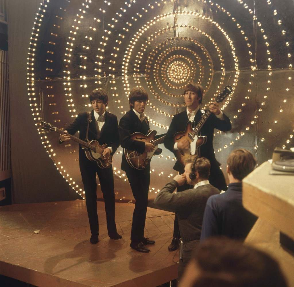 The Beatles perform at TV studios in London, June 1966, prior to their tour in Germany and Japan. From left to right: Paul McCartney, George Harrison and John Lennon. (AP Photo)