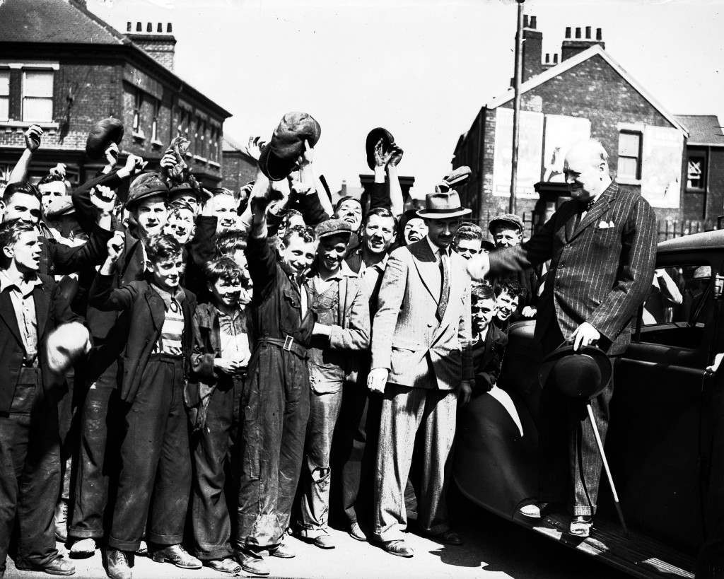 Winston Churchill is cheered by shipyard workers after a short speech at a shipyard in north east England, Aug. 1, 1940 PA-8635639