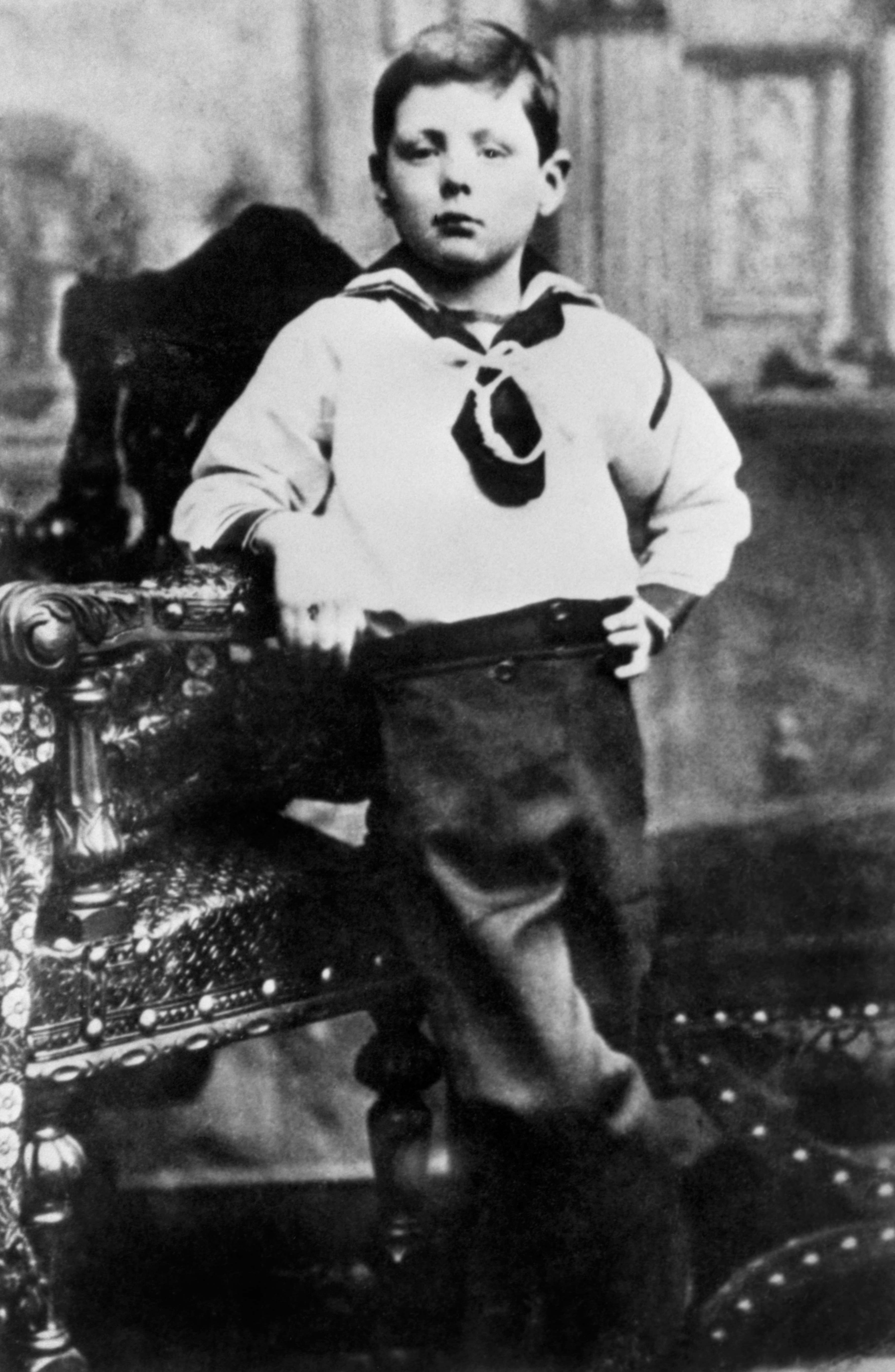 Winston Churchill as a seven year old in a seaman's suit.