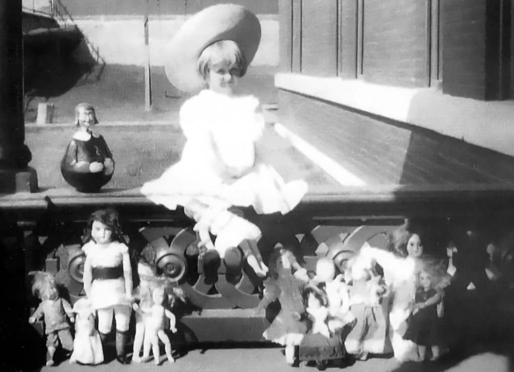 Huguette Clark with her dolls on the porch of the Clark mansion in Butte, c. 1910-11.