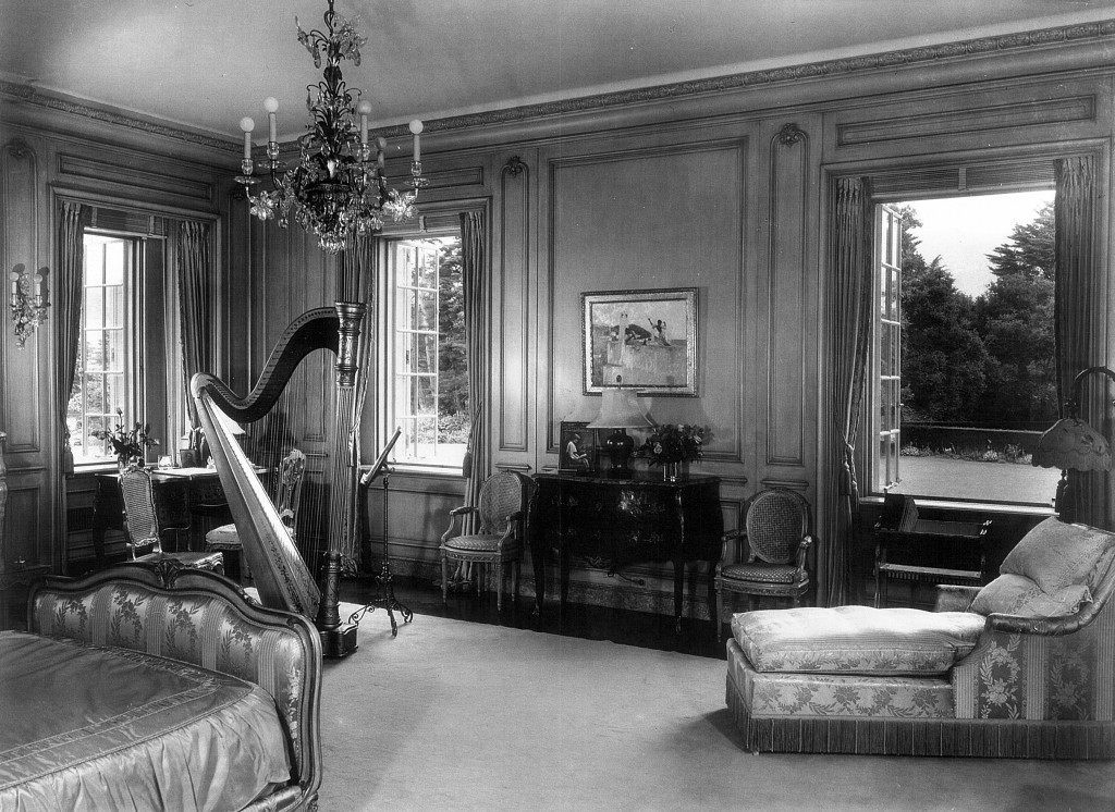 The bedroom of Anna Clark, Huguette's mother, at Bellosguardo, the Clark summer home in Santa Barbara, California, c. 1940. One of her French pedal harps sits at the foo of the bed. A painting by Sargent hangs between the windows. Photos of Anna's husband, Sen. W.A. Clark, and their elder daughter, Andrée, are on display here. No one from the immediate family has visited Bellossince the early 1950s.