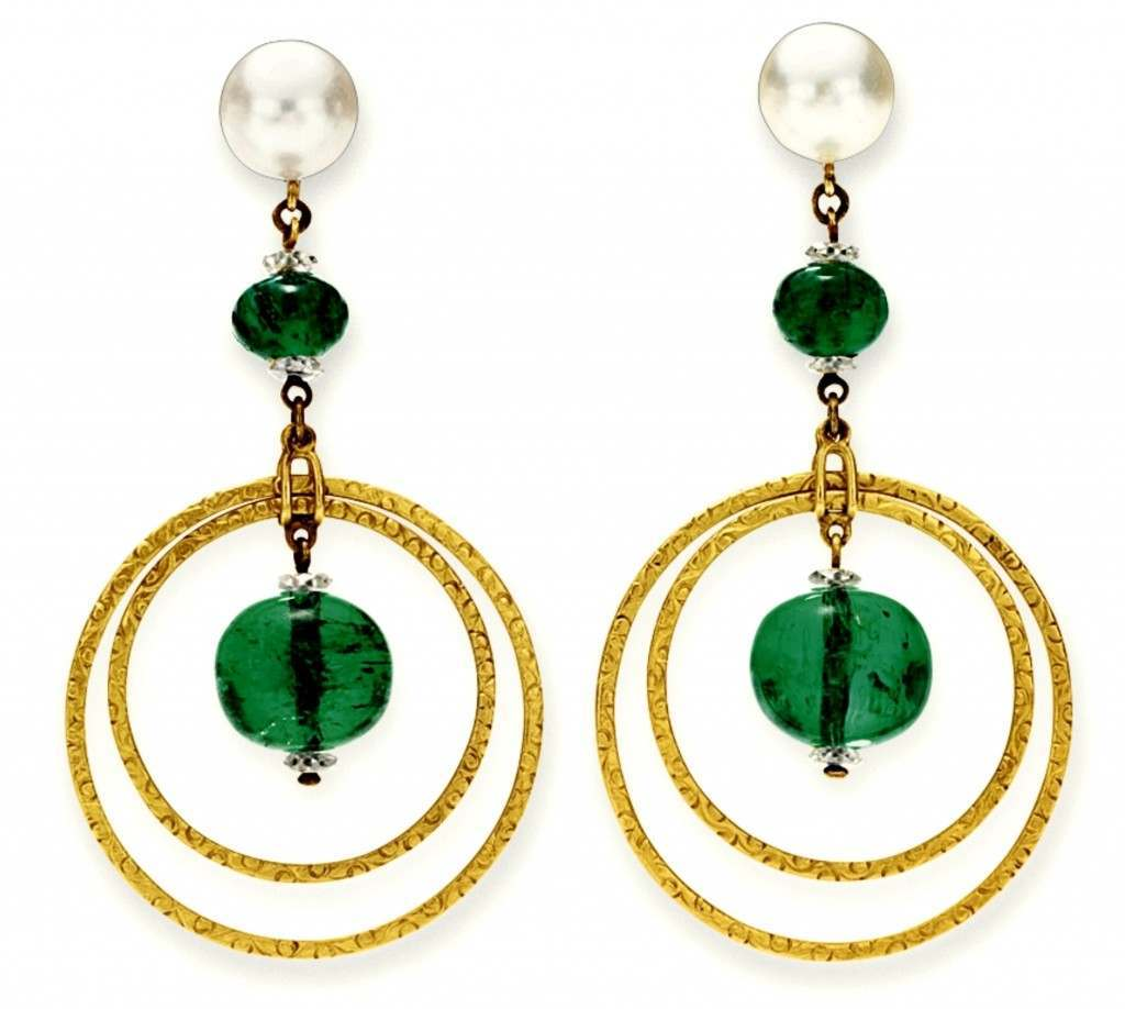 A pair of emerald, natural pearl and diamond ear pendants, by Cartier, early 20th century. Sale price in 2012, $85,000. All these items found in Huguette Clark's safe deposit box were auctioned on April 17, 2012, by Christie's New York.