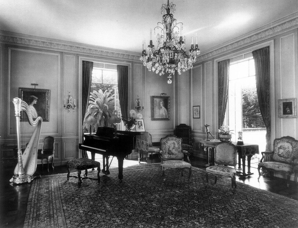 Portraits of the daughters by Tadé Styka flank a Steinway piano in the music room a Bellosguardo, the Clark summer home in Santa Barbara, California. One of their mother Anna Clark's French pedal harps is at left. No one from the immediate family has visited since the early 1950s. this photo is from about 1940.