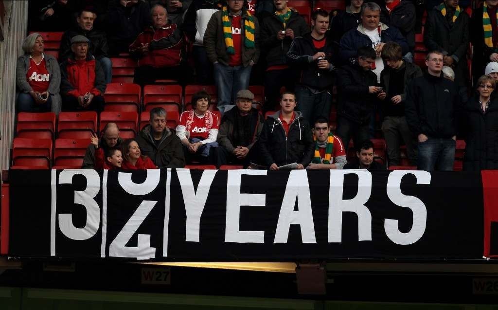 MANCHESTER, ENGLAND - FEBRUARY 12:  Manchester United fans display a banner depicting the last time City won a trophy during the Barclays Premier League match between Manchester United and Manchester City at Old Trafford on February 12, 2011 in Manchester, England.  (Photo by Alex Livesey/Getty Images)
