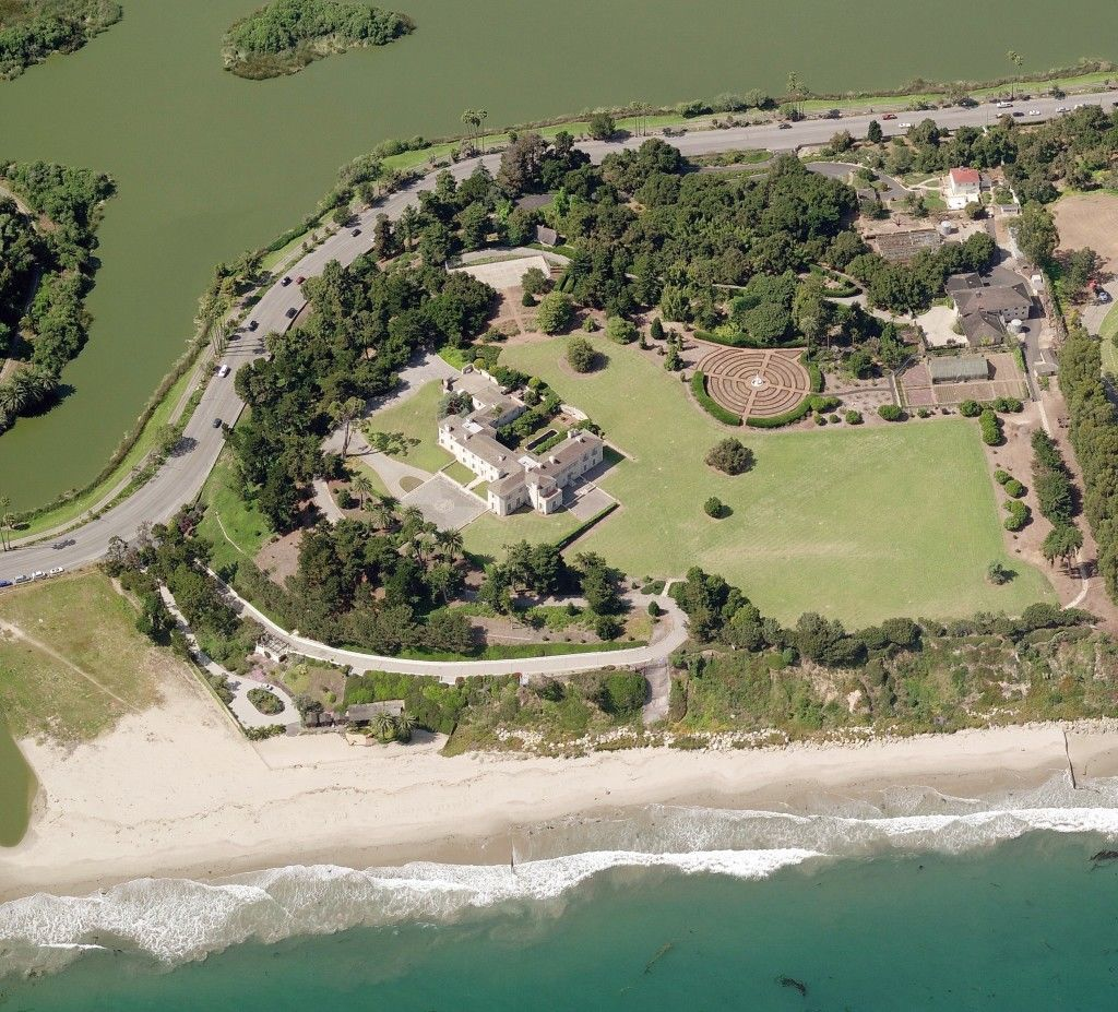 Bellosguardo, the Clark estate in Santa Barbara, California. At the top of the photo is the Andrée Clark bird refuge, which Huguette Clark paid for in 1928 as a memorial to her sister. Cabrillo Boulevard snakes between the bird refuge and the Clark property. The front driveway rises alongside the bluff and makes a hairpin turn in front of the house. At center right is the circular rose garden. At the upper right, with the red roof, is the estate manager's house. No one from the immediate family has visited since the early 1950s.