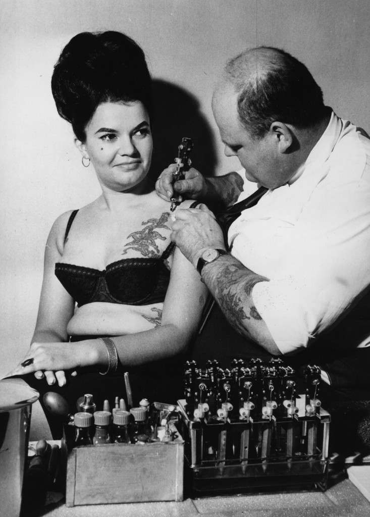 A tattooist at work on a client.    (Photo by Keystone/Getty Images)