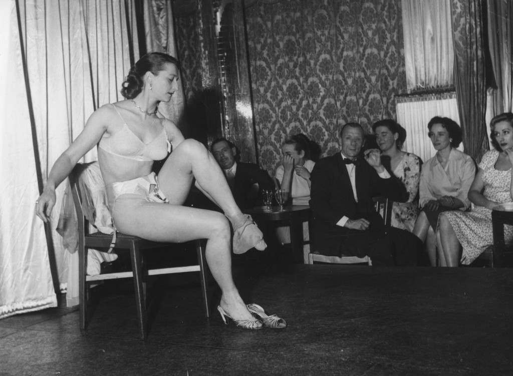sex, stripping, London, Raymond REvue, Soho, An amateur stripper performing at the Raymond Revuebar in London. Audience members may enter the striptease contest and the winners are awarded prizes.   (Photo by John Pratt/Getty Images)