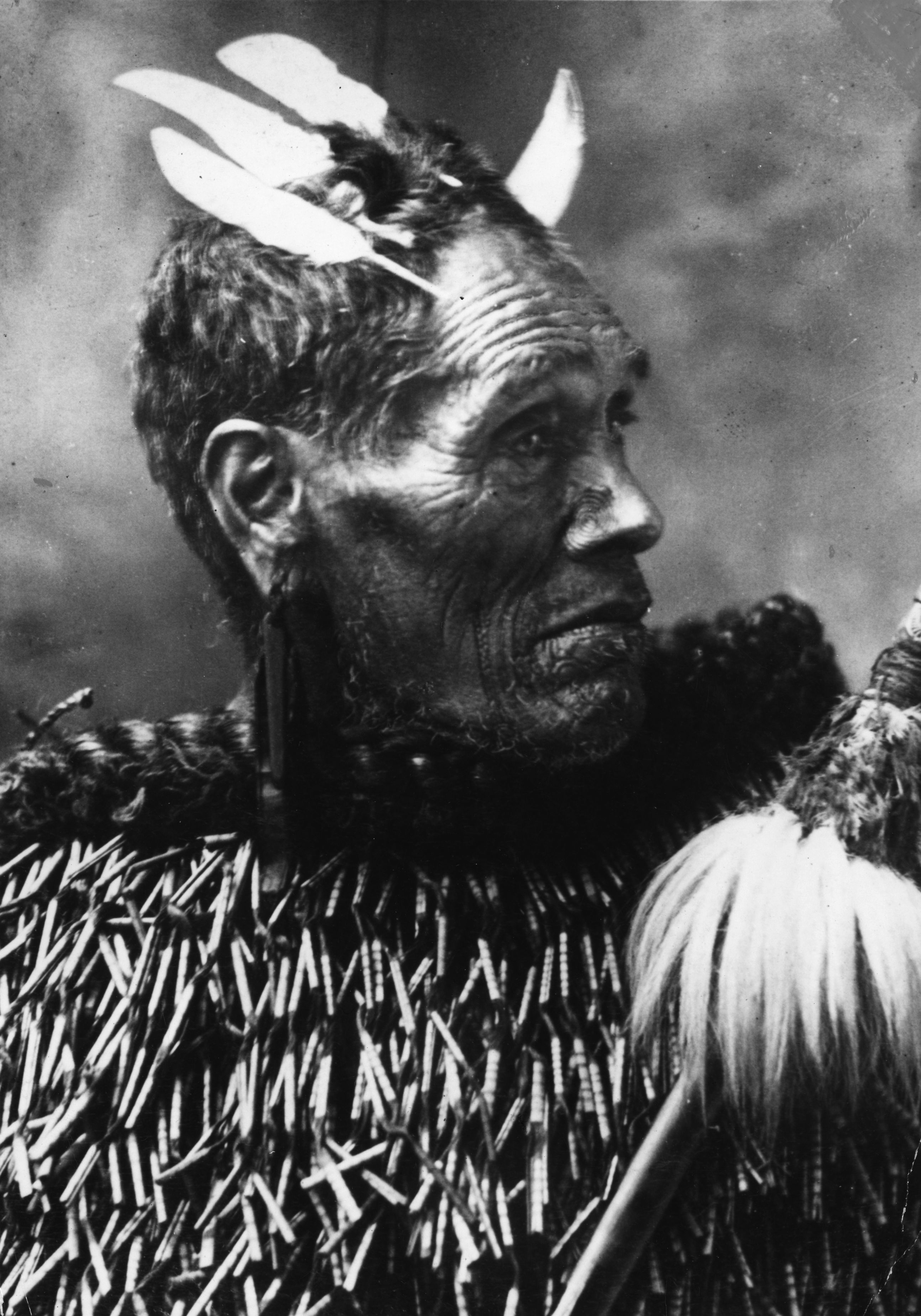 1870:  A Maori chieftain with tattooed chin and nose. He also wears earrings and has feathers in his hair.  (Photo by Hulton Archive/Getty Images)