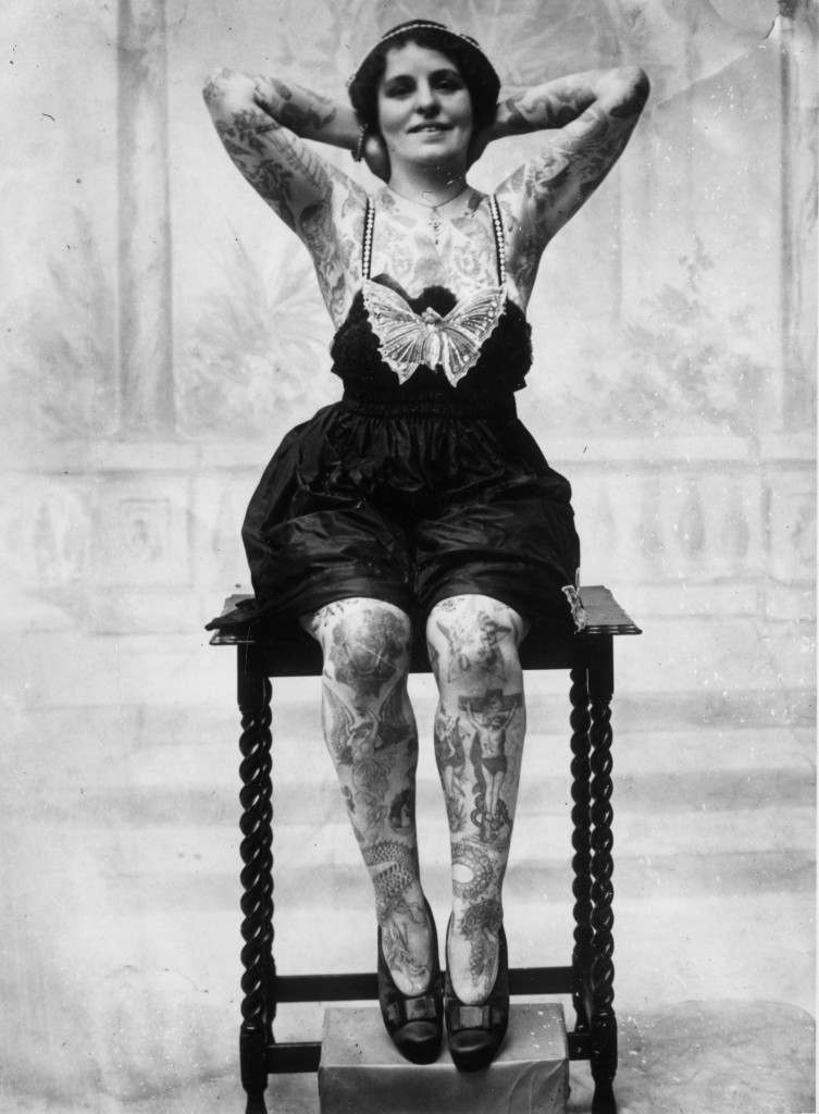circa 1930:  A tattoo enthusiast whose body is covered with images of dragons, flowers and religious scenes.  (Photo by General Photographic Agency/Getty Images)